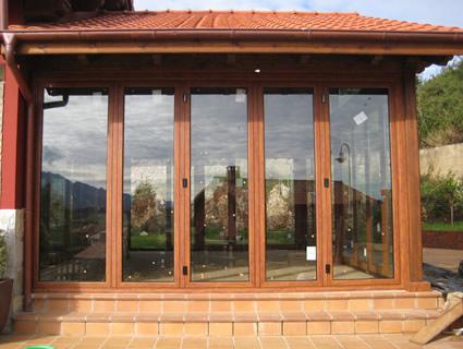Ventanas de aluminio color madera cool alta calidad arco for Ventanas pvc color madera
